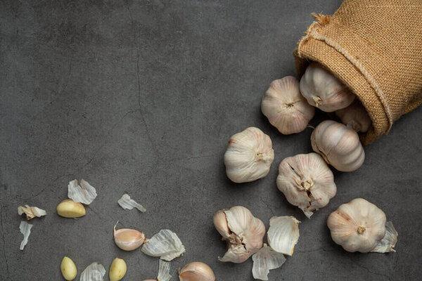 Garlic paste on a black background