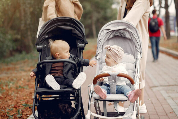 Mothers with children. Women use the carriages.