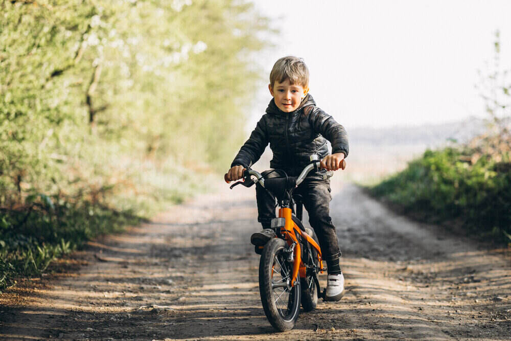 Little boy on bicycle in park
