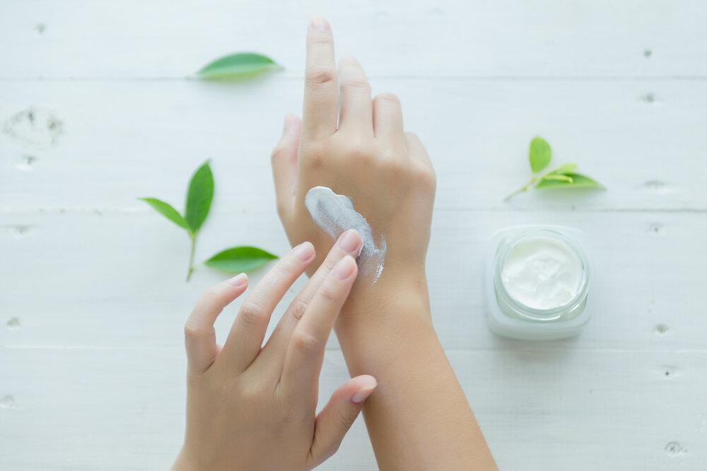 Skincare. Woman taking care of her dry complexion. Starostlivosť o kožu. Žena sa stará o svoju suchú pokožku na rukách.